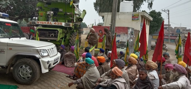 Farmers want combines back, dare cops to stop them