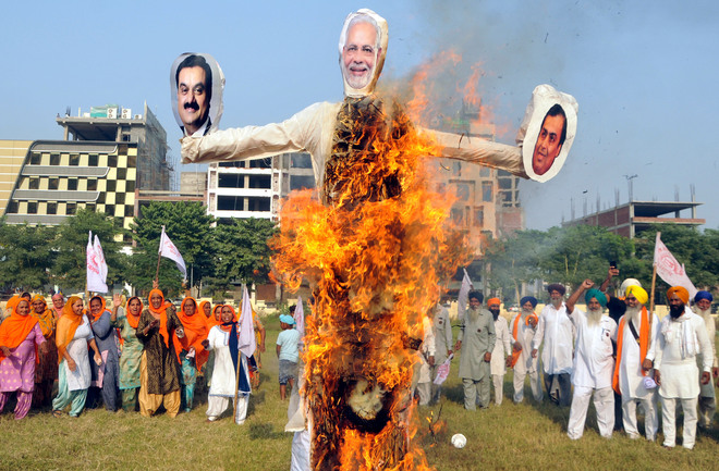 Farmers burn effigies of PM Modi, Ambani and Adani
