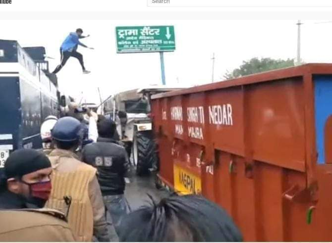 Farmer climbs atop police vehicle during protest, turns off water cannon; photo goes viral