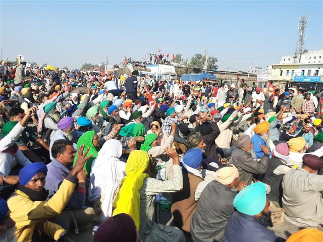 Slogans, songs and drumbeats as hundreds of farmers gather at Burari ground