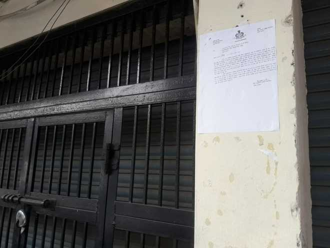 Notices pasted outside gun houses in Tarn Taran