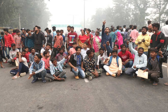 Migrant workers protest by blocking national highway in Ludhiana