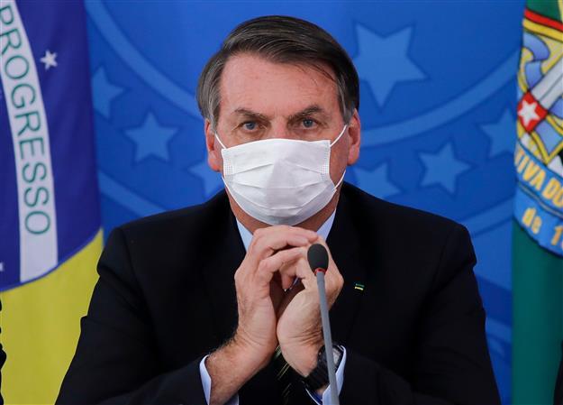 Brazil president  Bolsonaro still tests positive for virus