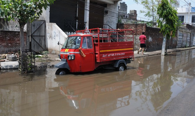 Rain brings relief; outages play spoilsport in localities