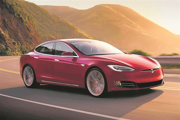 Tesla drives past Toyota  in market cap