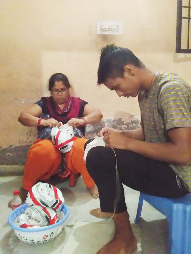 This athlete is stitching footballs to help his family