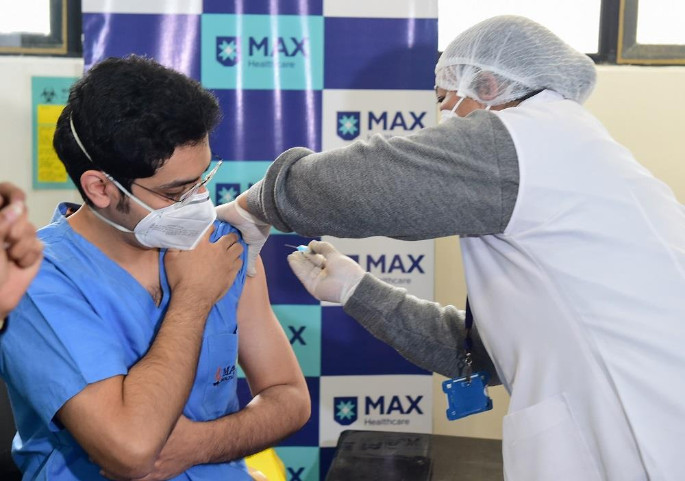 COVID-19 vaccination drive: Healthcare workers get first shots in Delhi amid cheers, applause