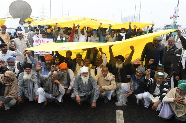 Firm on their demands, farmers brave cold, rain as talks with govt remain deadlocked