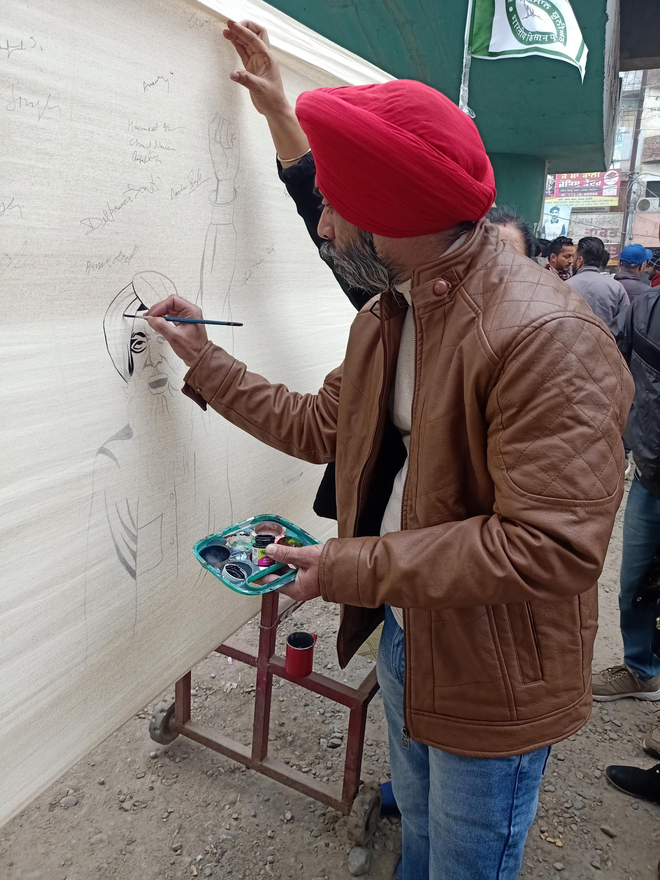 Moga artist's big flag captures stir mood