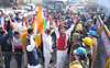 Farmers protest outside minister Anup Dhanak's house