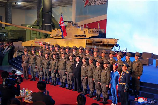 Pic of soldier wearing super-tight blue outfit while posing with Kim Jong-un goes viral