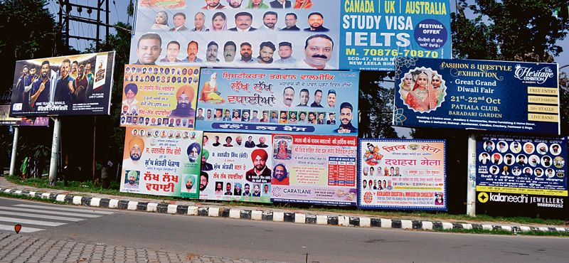 Hoardings continue to deface city, Patiala Municipal Corporation looks other way