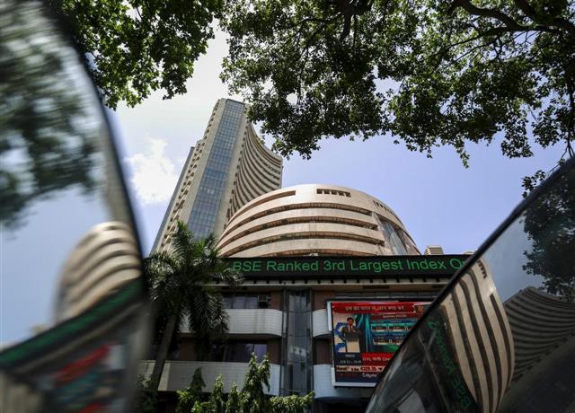 Sensex, Nifty at new peak; auto, power stocks shine