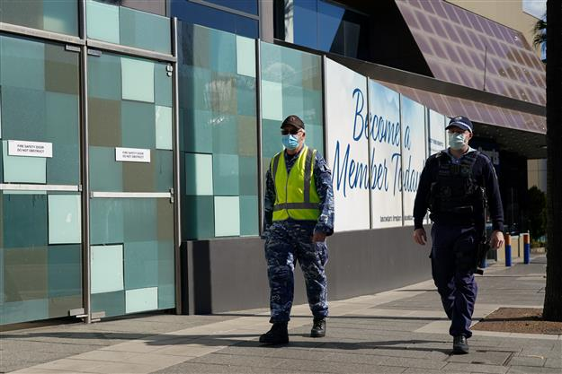 Melbourne set for Covid lockdown exit despite record cases as vaccinations spike