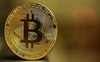 Bitcoin sets high, tops $66,000 on mainstreaming excitement