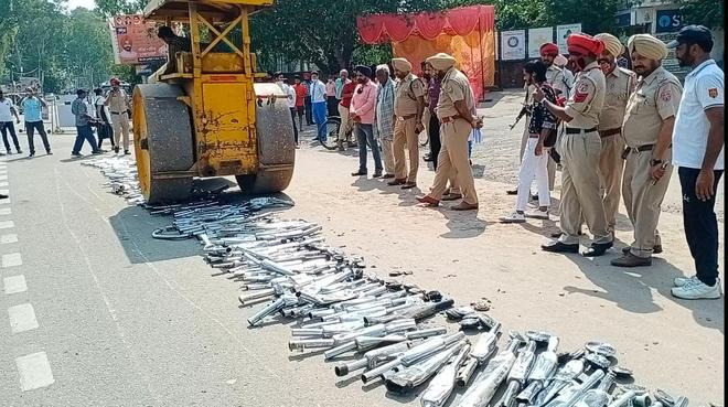 Police crush modified silencers, horns of bikes with road roller