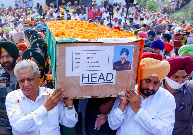 Tearful adieu to soldiers killed in J&K