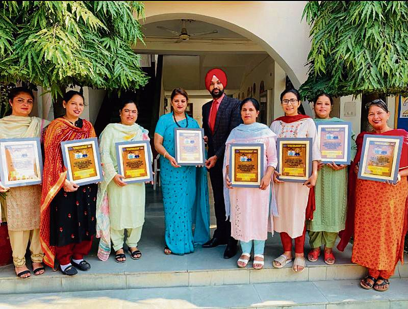 Principal, teachers given awards