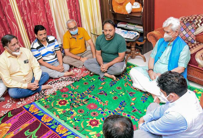 J&K L-G Manoj Sinha meets slain teacher's family