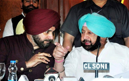 Sidhu, Capt in war of words over farm laws