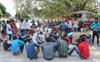 Fleeing Kashmir, migrants make a beeline for railway stations, bus stands