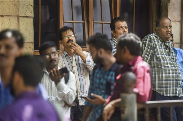 Sensex sinks 1,145 points; Nifty drops below 14,700