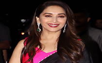 Madhuri Dixit reminds fans 'smiling is like superpower', shares sun-kissed picture