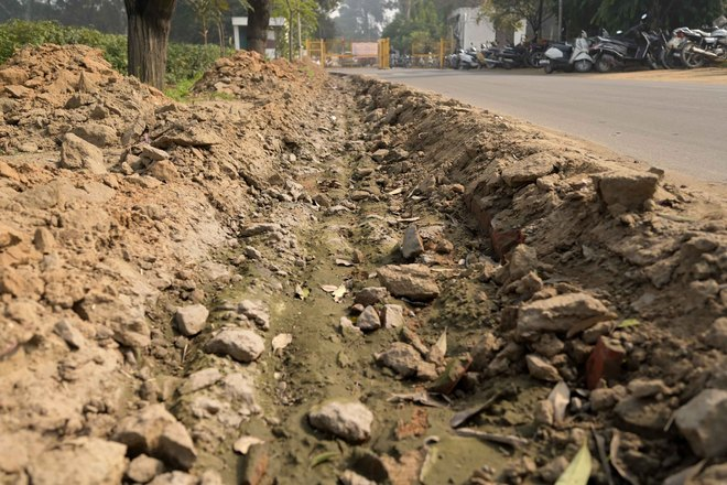 Dug-up road stretch in PAU irks residents