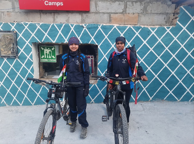 Two girl cyclists on women safety mission