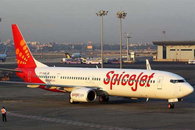 Passenger on SpiceJet's Delhi-Varanasi flighttries to open emergency door mid-air