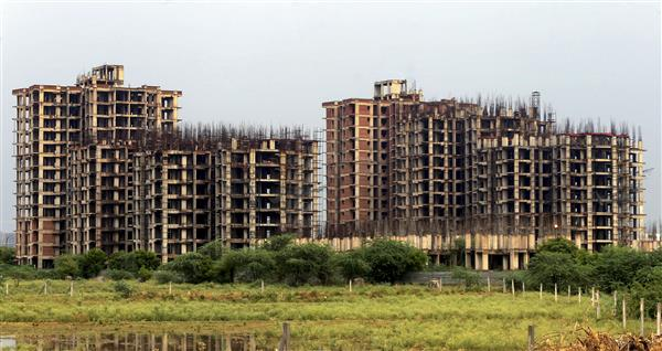 Flushed with liquidity, banks cut home loan rates to decadal lows