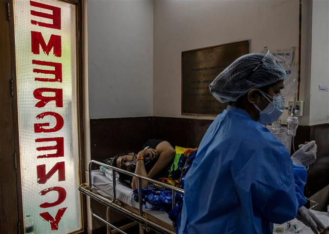 Record 395 COVID-19 deaths in Delhi, positivity rate over 32.82 pc with over 24,000 new cases