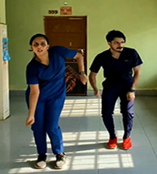 Dancing medicos in scrubs inspire cops to bat for vaccines