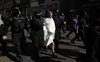 Topless woman arrested at Windsor Castle during royal funeral in UK
