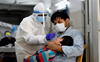 India records 1,61,736 Covid infections, 879 deaths
