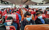 Empty middle seats may reduce COVID-19 exposure on flights, lab study finds