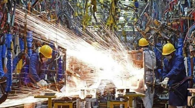 Factory output slows to 7-month low in March