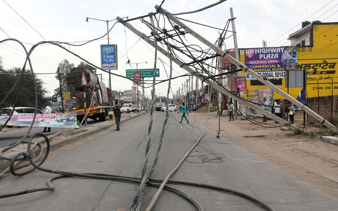 Heavy machinery-laden truck damages electricity poles, wires near Gilco Valley