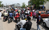 Dhakoli traders up in arms, block road