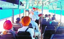 Health officials distribute masks among bus passengers