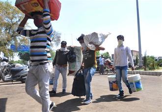 Fearing curbs, migrants head back home