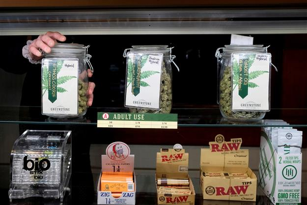 US legal marijuana sellers stash cash as banks leave them high and dry