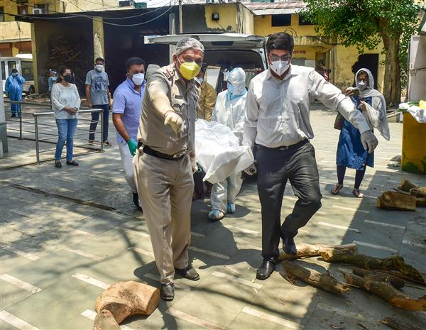 'Feel assisting people in distress my duty': Delhi Police ASI who helps cremate Covid dead