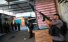 Rio police draws international ire as 25 killed in drug gun battle