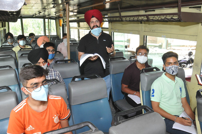Chemistry prof takes lecture in bus, booked