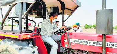 DC drives tractor to spread info on direct rice seeding