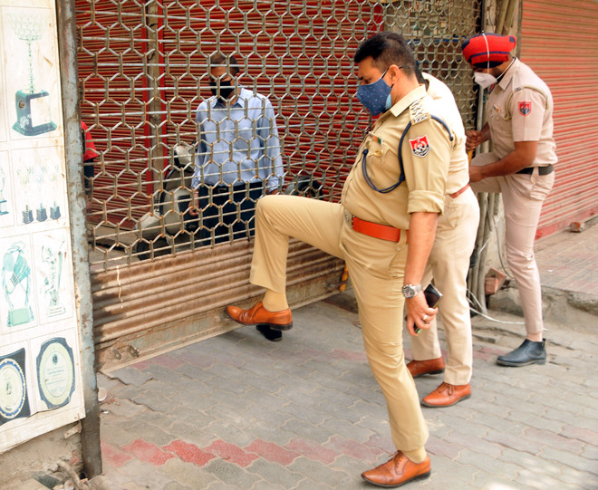 Believing curfew's over, traders open their establishments