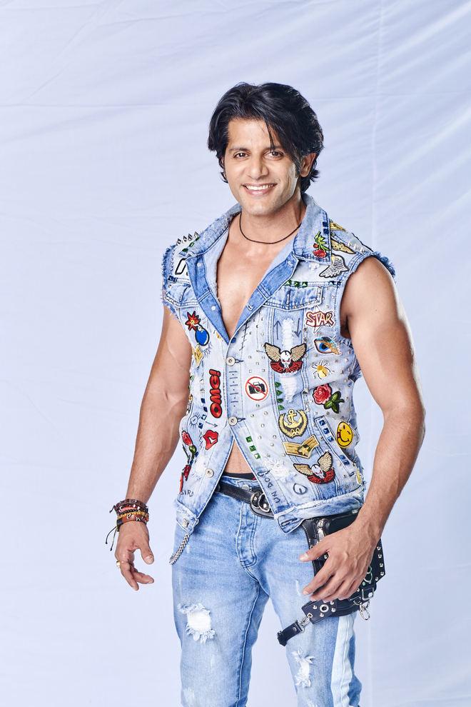 Karanvir postpones his return to India