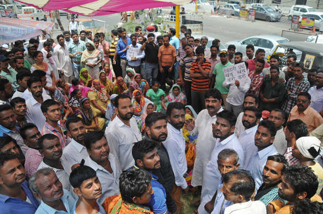 Sanitation workers continue protest in Patiala