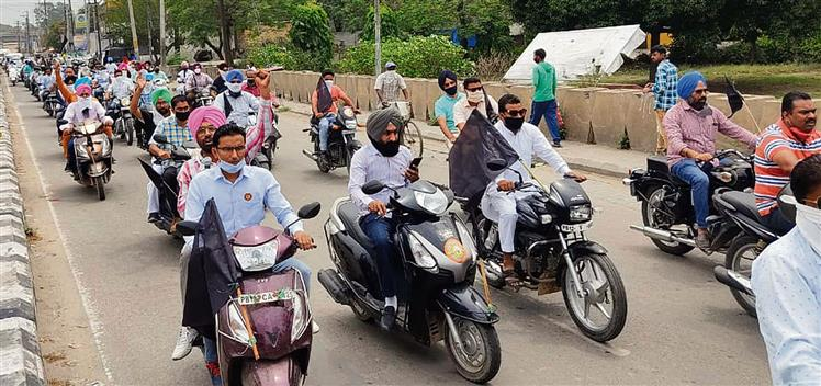 Members of  Sanjha Adhyapak Morcha hold protest march